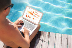 Businessman working on laptop by the pool Royalty Free Stock Photos