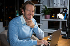 Businessman working on laptop Royalty Free Stock Images