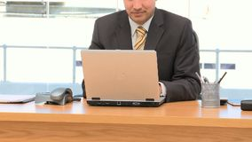 Businessman working on a laptop stock footage