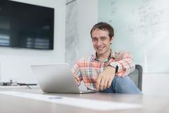 Businessman working laptop sitting office desk Stock Images