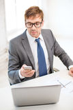 Businessman working with laptop and smartphone Royalty Free Stock Photos