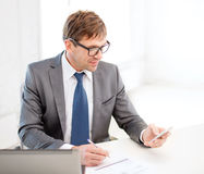 Businessman working with laptop and smartphone Stock Photography
