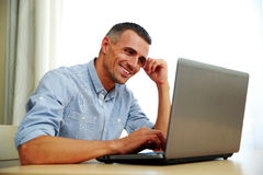 Businessman working with laptop Stock Images