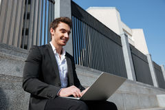 Businessman working with laptop Stock Image