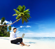 Businessman Working Laptop Summer Beach Concept Stock Images