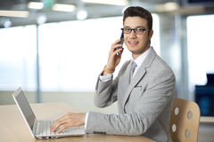 Businessman  working on laptop and talking telephone Stock Photo