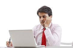 Businessman working on a laptop. And thinking Royalty Free Stock Photo