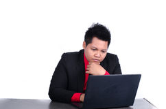 Businessman working with laptop on white Stock Images