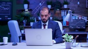 Businessman working late at night in the office stock footage