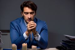 The businessman working late in office with candle light. Businessman working late in office with candle light royalty free stock images