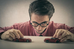 A businessman working with little cars royalty free stock photos