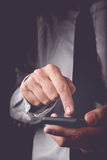 Businessman working on mobile smart phone Royalty Free Stock Images