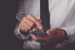 Businessman working on mobile smart phone Stock Photography