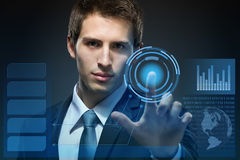 Businessman working with modern virtual technology. Pressing keys on touch screen on black background Stock Photos