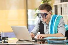 Businessman working needing vacations Royalty Free Stock Image