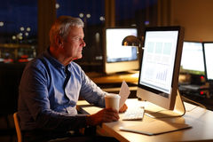 Businessman working at night Stock Photography