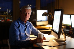 Businessman working at night Stock Image
