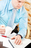 Businessman working with notebook. Closeup of a businessman working with notebook stock photos