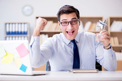 The businessman working in the office Stock Photo