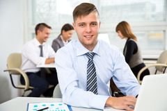 Businessman working in an office. Businessman working with computer in an office Royalty Free Stock Photo