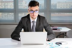 Businessman working in an office. Businessman working with computer in an office Royalty Free Stock Photos
