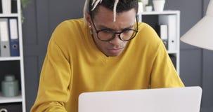 Businessman working on office laptop. Focused african american businessman working on laptop at office stock video footage