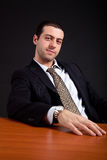 Businessman working in the office in low light Royalty Free Stock Photos