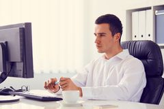 Businessman working in the office, toned. Young businessman working in the office, toned stock images