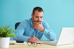 Businessman working in office Stock Image