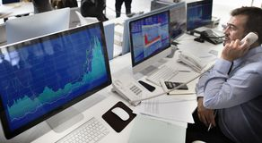 Businessman working on online stock exchange team stock photo