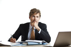 Businessman working out a problem Stock Photos