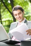 Businessman working, outdoor Royalty Free Stock Image