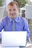 Businessman working outdoor, with laptop Stock Photos