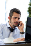 Businessman working outdoor with mobile and laptop Royalty Free Stock Photography