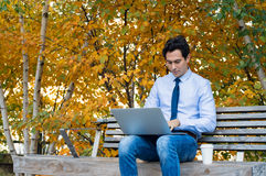 Businessman working outdoor Royalty Free Stock Image