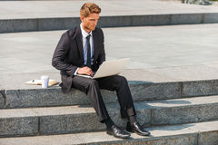 Businessman working outdoors. Royalty Free Stock Image