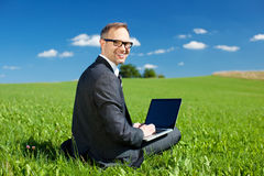 Businessman working outdoors under a blue sky Stock Images