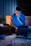 Businessman working overtime at home until late Stock Photography