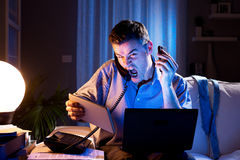 Businessman working overtime at home Stock Photo