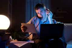Businessman working overtime at home Royalty Free Stock Photo