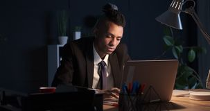 Businessman working overtime at office stock video footage