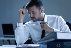 Businessman working overtime Stock Photos