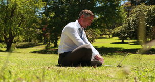 Businessman working in the park stock footage