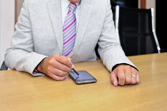 Businessman working with phablet. Close-up of a businessman working with a phablet as a concept of technology in business Stock Photography