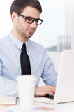 Businessman at working place. stock photo