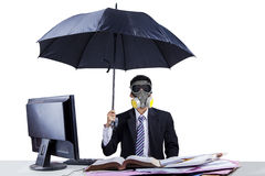 Businessman working in pollution concept Stock Photo