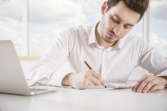 Businessman working on project Royalty Free Stock Image
