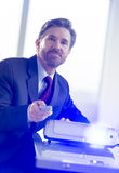 Businessman Working With Projector At Desk Stock Photos