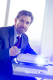 Businessman Working With Projector At Office Desk Royalty Free Stock Photography
