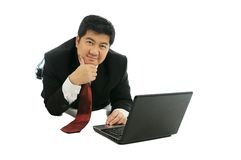 Businessman working in prostrate Royalty Free Stock Image